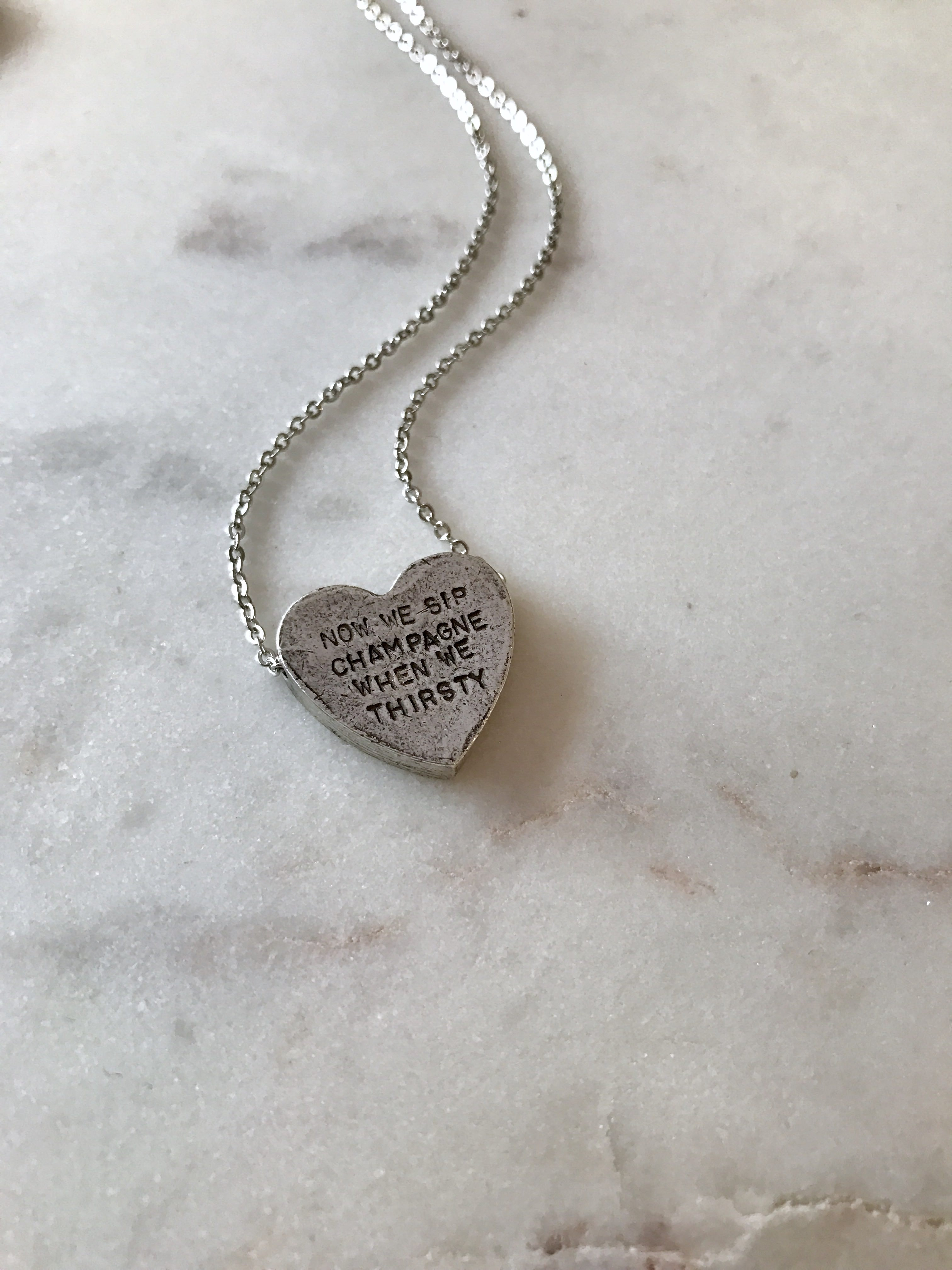 """now we sip champagne…"" heartbeats necklace"